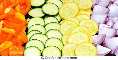 Cut vegetables for a healthy meal - Rows of sliced...