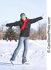 Skating - Ice skating Woman skating on ice with figure...