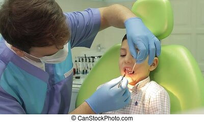 Dentist and young boy - dental clinic