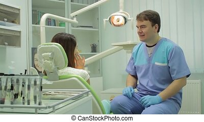 Dialogue between patient and doctor - dental clinic