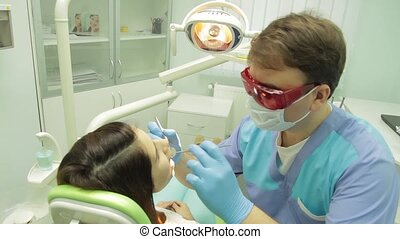 Patient examination by the  dentist - dental clinic