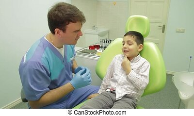 Dentist and young boy