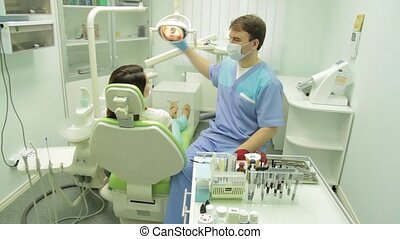 Patient examination by the  dentist - Patient examination