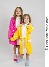 Two girls standing in robes