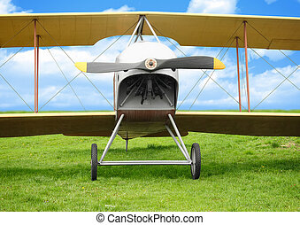 Old airplane on green grass - Old vintage airplane on green...