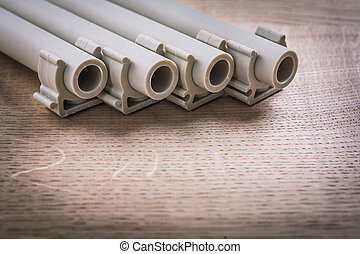 Polypropylene Pipe With Clips On Wooden Board