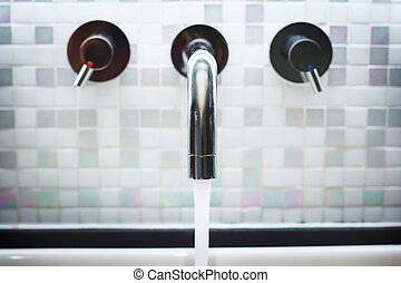 Faucet in Bathroom with Running Water