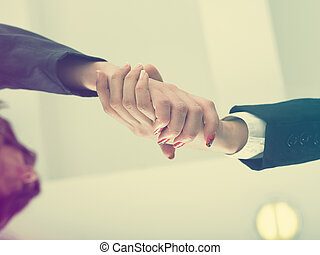 Handshaking in office low angle - Office Handshake...