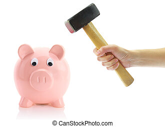 Hand with hammer and piggy bank, isolated on white