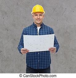 smiling male builder in helmet with blueprint - repair,...