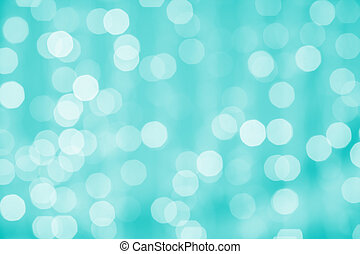 blurred background with bokeh lights - holidays, party and...