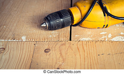 Electric well used power drill, close up with copy space