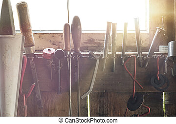 Set of various handyman tools, with sunflare coming through...