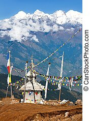 Ganesh Himal with stupa and prayer flags - Nepal - view from...