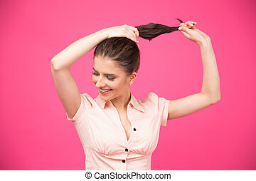 Happy young woman making her hair