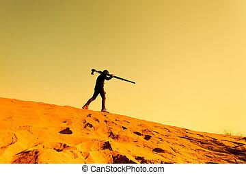 A man walking on sand desert