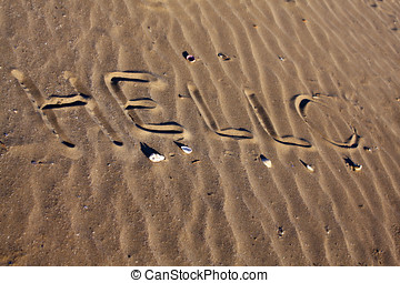 Sand Background - Hello written in the sand by the beach
