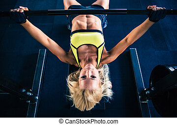 Woman workout with barbell on bench - Fitness woman workout...