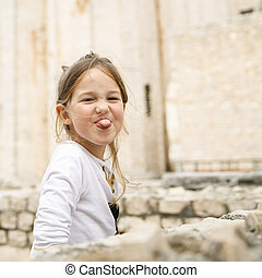 Carefree Caucasian girl making faces - Playful and carefree...