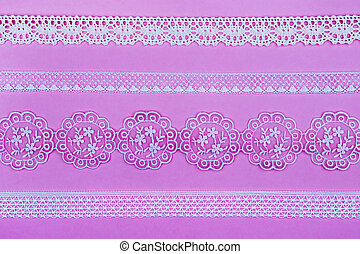 Lace - 4 different lace borders against pink background.
