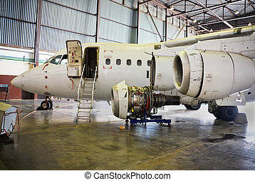 aircraft maintenance - dismantled plane engine under...