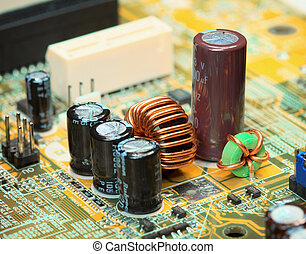 Electronic components on a computer plate close up