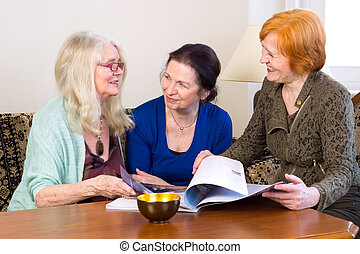 Middle Age Women Friends Talking at Living Area - Three...