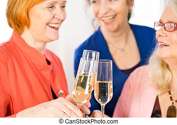 Glasses of White Wine Tossed by Happy Adult Ladies - Close...