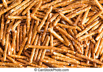 Plenty Salted Baked Pretzel Sticks for Backgrounds - Close...