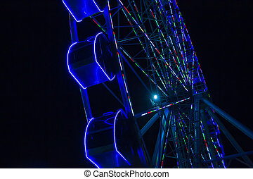 Ferris Wheel at Night - Nightime attraction of a ferris...