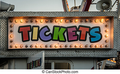 neon ticket sign - Ticket office sign at a country fair in...