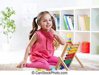 child girl playing with abacus