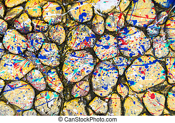 Yellow Paint Drip Stones - Stones covered in paint drops and...