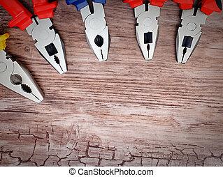 copyspace image set of pliers on wooden board - copyspace...