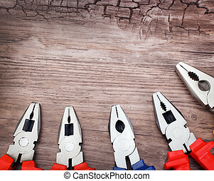 copyspace image set of pliers on wooden board - copyspace...