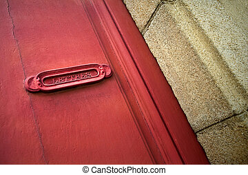 Letter box - Old French letter box of a red door