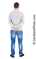 Back view of man in jeans.