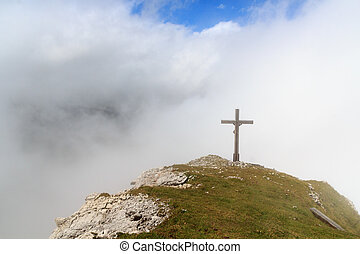 Summit cross Wiedemerkopf in the clouds