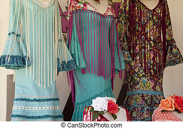 Traditional flamenco dresses at a shop in El Rocio village,...