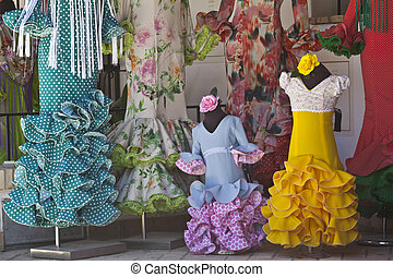Traditional flamenco dresses at a shop in El Rocio village,...