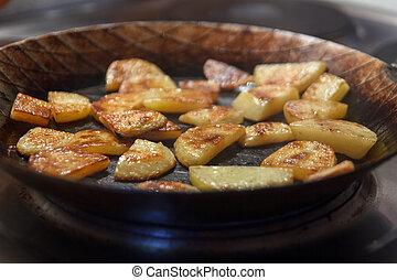Chips in iron frying pan - Chip potatoes in iron frying pan