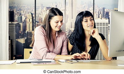 Women at work chatting on computer