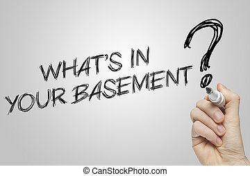 Hand writing whats in your basement on grey background