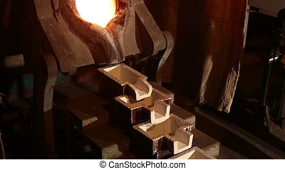 Smelting of Gold - Molten Gold being poured into Ingot...