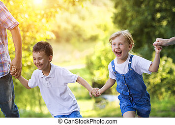 Happy family - Happy little girl and boy having fun with...