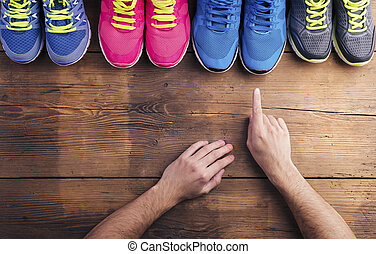 Running shoes on the floor - Four pairs of various running...
