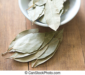 bay leaves on a wooden table