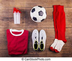 Football stuff on the floor - Various football stuff lined...