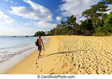Madagascar beach - Young man on a beautiful isolated...