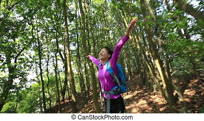 cheering woman hiker open arms - cheering young woman hiker...